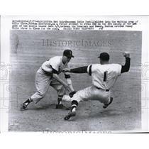 1957 Press Photo Nationals third baseman Eddie Yost slides into Bostons Klaus