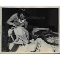1945 Press Photo American World Airways Liferaft Receiving Overhaul - nee67596