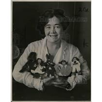 1924 Press Photo Carroll Shenne and toy dolls