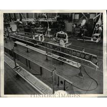 1961 Press Photo A cradle for engines at North American Aviation Inc.