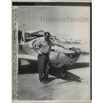 1957 Press Photo Tom McMurray, New Orleans Pilot stood by rebuilt plane