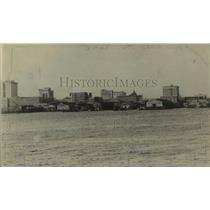 1920 Press Photo A view over water of a city skyline