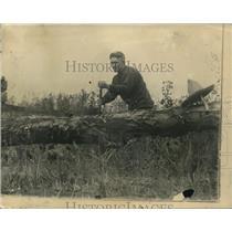 1922 Press Photo Johnny Kilbane chops wood during training