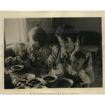 1940 Press Photo Evacuees Fed Aboard Trans-Pacific Plane Headed for America