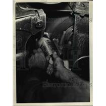 1927 Press Photo National Acme Co a worker grinds inside a knee action part