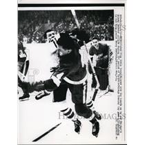 1961 Press Photo Red Wings Howie Young vs Black Hawks Murray Balfour in Detroit