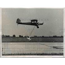 1955 Press Photo Stuntman Howard Libersky at Air Show & Pilot Roy Tim Performing