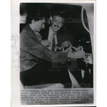 1955 Wire Photo Gerry Smith tries out controls of Cessna 172 airplane