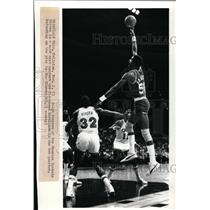 1983 Press Photo Ralph Sampson of Houston Rockets Shoots, Cavalier's Roy Hinson