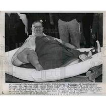 1956 Press Photo Robert Hughes Weighing 1041 Pounds Loaded on Cargo Plane