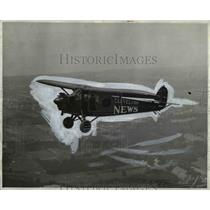 1929 Press Photo Cleveland News monoplane flying high on its way - cva96869