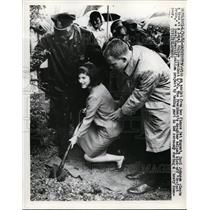 1966 Press Photo With assist from finace Pat Nugent, Luci Johnson plants a tree.