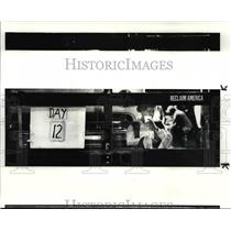 1984 Press Photo Lorene Meadwell watches the snow fall outside station 25