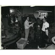 1987 Press Photo Mike Brooks talks with father, John at William Shoe factory