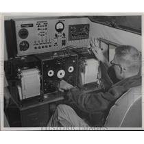 1953 Press Photo Philip shows how maintain proper level during aerial survey