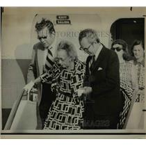 1973 Press Photo Mrs. Eddie Rickenbacker helped from plane David, William