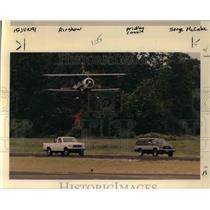 1991 Press Photo Lee Oman, Speeding pickup Stunt Pilot Jim Franklin Rose Festiva