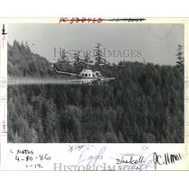 1986 Press Photo Aerial Spraying Insecticide Gypsy Moth Lane County Oregon