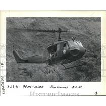 1990 Press Photo Officials searching for marijuana gardens in a UH-1 helicopter