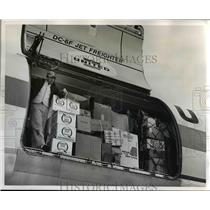 1965 Press Photo United Air Lines Crew Member Unloads Relief Supplies - orb12558