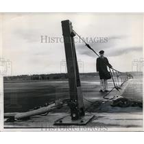 1960 Press Photo Maj RW Riedel demostrates Port International Airport barrier