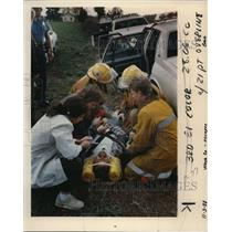 1988 Press Photo Crews Treat Inmate Wallace Nelson After Crash - ora68440