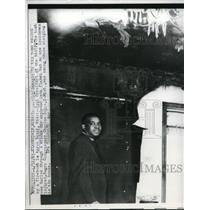 1963 Press Photo Aaron Henry inspects his Mississipi home damaged by firebomb