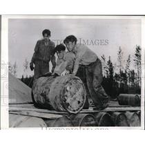 1945 Press Photo Indians of Northwest Territories roll drums of supplies
