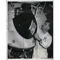 1956 Press Photo JP Lotz installs C band radar unit in United plane - neb40298