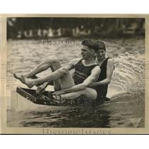 1925 Press Photo A man & woman on a water surfing gizmo in a lake - neb63999