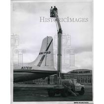1958 Press Photo United Airlines hydraulic lifts for inspection of DC-8 planes
