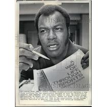 1974 Press Photo Cookie Gilchrist Shows Brochure for United Athletes Coalition