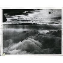 1935 Press Photo Hidden Sun Sends Light Through Clouds Visible from Plane