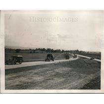 1940 Press Photo Truck and Motor-drawn Howitzers speeding along  Superhighway
