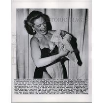 1954 Press Photo Strong Woman Mighty Mannequin Joan Rhodes Bends Steel Bar