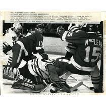 1969 Press Photo Blackhawks Alain Chevrier vs Red Wings Paul MacLean
