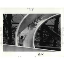 1983 Press Photo Two People Going Down Geauga Lake Water Slide in Ohio