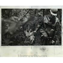 1974 Press Photo Crow hacked way through underbush in search of trail