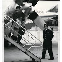 1965 Press Photo First passenger to step off a plane at the new Spokane Airport