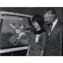 1962 Press Photo Irving Flegel explains the features of terminal to Miss Amick