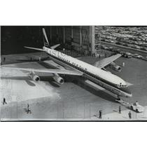 1966 Press Photo Super 61 DC6 leaves construction hangar at Long Beach, Calif.