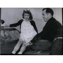 1943 Press Photo Major Eugene P. Roberts seats June Rose on a Thunderbolt