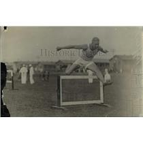 1918 Press Photo Track star Leffler jumps over hurdles during event - net04727
