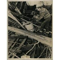 1940 Press Photo Man examines wreckage of home destroyed by tornado - nee94697