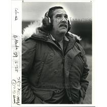 1985 Press Photo Bundled up to keep warm and wearing noise protectors.