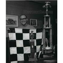 1968 Press Photo Dave Heerensperger holding checkered flag and Trophy he won