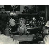 1984 Press Photo Adeline Ferraro serves booze and beer in her Downtown bar
