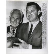 1960 Press Photo Eagles coach Buck Shaw and QB Norm Van Brocklin sign a ball