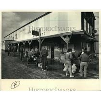 1987 Press Photo People waited outside W.B. Place & Co. with deer hides
