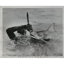 1953 Press Photo A Dominican sailor holding a shark by the nose in Beata Island